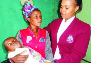 Lt Zama with Phumzile and her sister's handicapped child